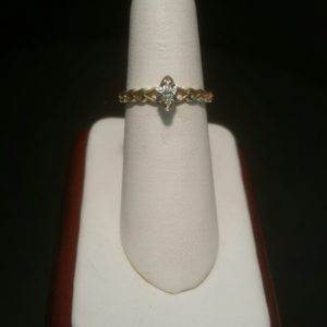 0K Yellow Gold Ladies Ring with Hearts on the Shank .08 CT Marquee