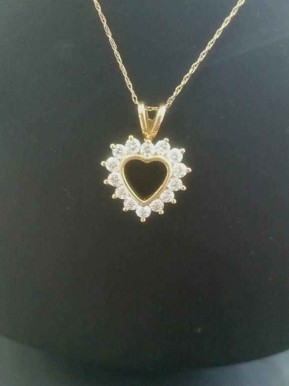 Pendants chains rainbow jewelers llc 14 karat yellow gold heart pendant surrounded by 14 diamonds with chain item no 09 128ej mozeypictures Gallery